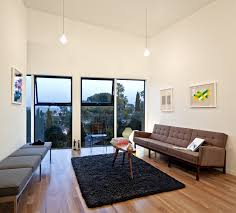 a single space living area helps this compact home to feel spacious