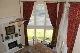 red pattern curtains having tie back and bronze curtains rod plus