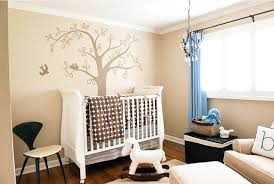 creamy brown wall themes with brown tree paint and blue curtains