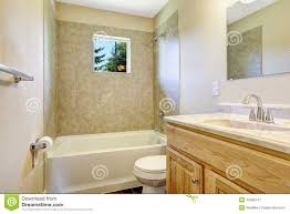 empty bathroom with tile wall trim and window stock photo image