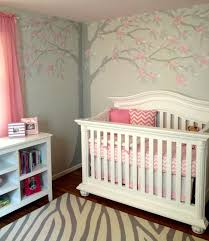 soft pink and gray painted walls ceiling and floral tree mural