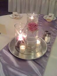 Purple Floating Candles For Centerpieces by Submerged Ice Branch Centerpiece Www Facebook Com