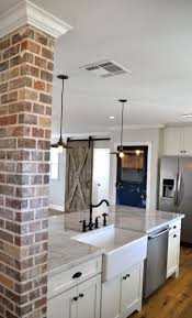 best 10 kitchen brick ideas on pinterest exposed brick kitchen exposed brick farmhouse sink sliding barn wood door and carrara marble light