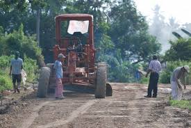 image of a village road being raked  and graded