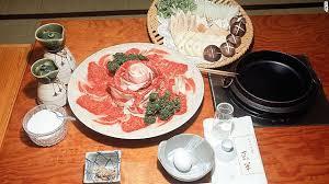 Sukiyaki  mix  simmer  dip in raw egg  emit murmur of satisfaction