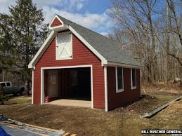this garage has a cement foundation red wood siding and a grey browse garage pictures and get inspired with examples of unique garage designs ideas layouts and more with designmine
