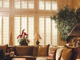 how to cover large windows with shutters sunburst shutters