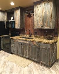 Photo Of Kitchen Cabinets A Little Barnwood Kitchen Cabinets And Corrugated Steel Backsplash