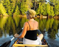 Image result for woman in a canoe