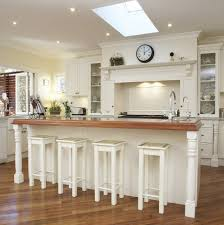 majestic galley kitchen with island layout and white wooden
