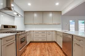 modern vertical white glass subway tile kitchen backsplash