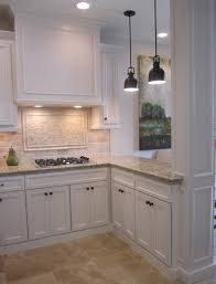 Commercial Kitchen Backsplash by Kitchen With Off White Cabinets Stone Backsplash And Bronze