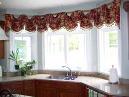 kitchen bay window with colorful curtain ideas and wooden cabinet