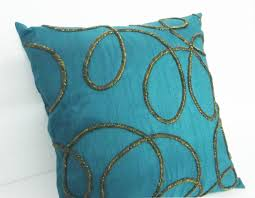home decor pillow spiral design on teal cushioncover with