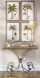 set of 4 ehret palm tree prints hanging over a console table all