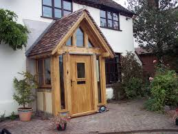 oak porch with glass surrounds with red tile pitched roof porch