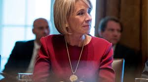 betsy devos calls for new way forward on sexual assault but no
