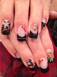black halloween freehand nail art with witch pumpkin graveyard