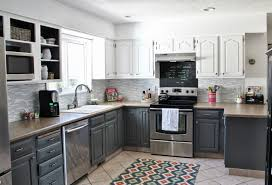 grey kitchen cabinets with black countertops grey metal chrome