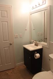 modern bathroom remodel with floor to ceiling tile