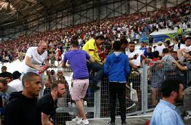 Russia thugs to be probed by Uefa for fighting  racist behaviour     Fans climb Stade Velodrome barriers in an attempt to escape the fighting