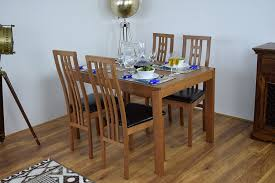 extending honey oak dining room table and 6 chairs solid wood