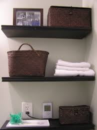 Bathroom Storage Shelves Over Toilet by White Floating Cabinet Over Toilet With Shelf And Towel Bar