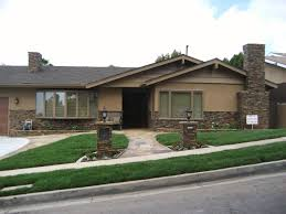 beautiful house with brown exterior walls accented stone excerpt