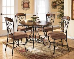 Chairs For Kitchen Table by Round Kitchen Table And Chairs With Brick Wall And Flower Vase On