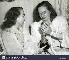 joan crawford with her oscar for mildred pierce in 1945 being