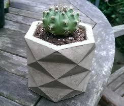 origami concrete planters on behance