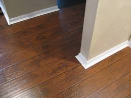 Uniclic Laminate Flooring Adura Dark Walnut Cost Carpet Cheapest Uk Wilsonart Diy For