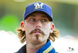 Milwaukee Brewers reliever John Axford had a insatiable craving for some Krispy Kreme donuts this past weekend and took to Twitter to help score some. - brewers-cubs-1