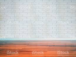 interior of modern empty brick wall with wooden floor stock photo