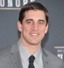 Football fans know that Aaron Rodgers, the quarterback of the Green Bay Packers, is a dynamic player. He's got a good arm, he can run, and he manages his ... - aaron-rodgers-getty