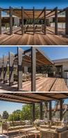 this large pergola has enough space for a large outdoor lounge and
