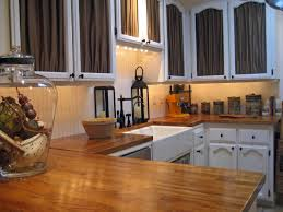 Small Kitchen With White Cabinets Butcher Block Countertops Installed In The Small Kitchen With