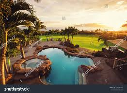 luxury home swimming pool sunset tropical stock photo 191280419