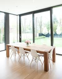 christie smythe and andrea lenczner eames chairs wood table and