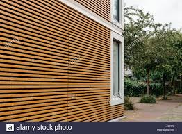 modern architecture facade with lining of wood slats stock photo