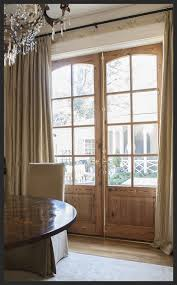 french doors double raised wood panel and 8 lite with eyebrow