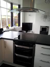 sleek modern black u0026 white kitchen with breakfast bar glass