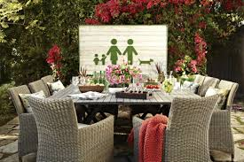 grey wicker dining doom set for outdoor with white wall panel