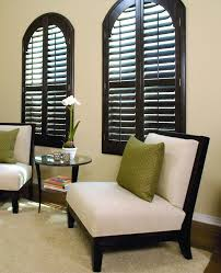 custom shutters can be made to cover arch top windows these