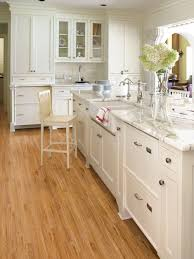 white kitchen cabinets and dark wood floors the top home design