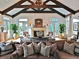 Exposed Beam Ceiling Living Room by Craftsman Living Room With Wall Sconce U0026 Chandelier In Long Beach