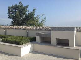 Raised Beach House by Buxus Pad Rendered Raised Bed And Outdoor Fireplace With