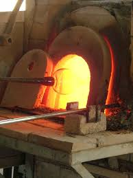 A glass oven for shaping and coloring,