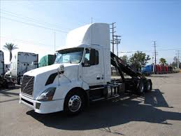 2004 volvo truck roll off trucks for sale