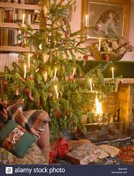 Home Made Decoration by Christmas Tree With Home Made Decorations And Lighted Candles